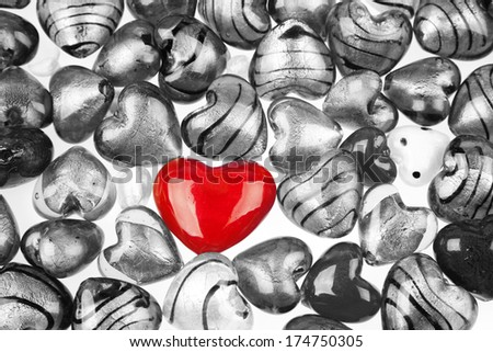 One red heart standing out in crowd - stock photo