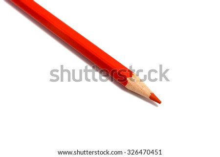 One red pencil on a white background