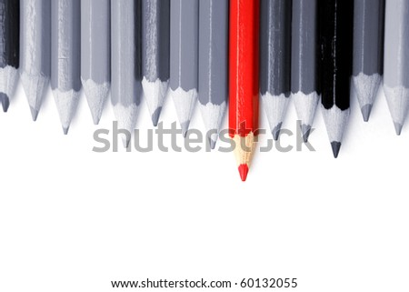 One red pencil standing out from dull pencils. Standing out from the crown concept - stock photo