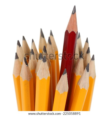 One red pencil standing out from others, isolated on white - stock photo