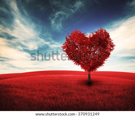 One red tree with shape of heart in filed - stock photo