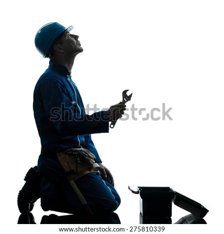 one  repairman worker despair praying silhouette in studio on white background - stock photo