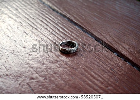 One ring on wooden background