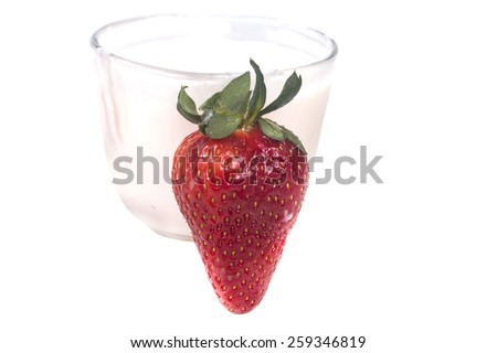 one ripe tasty strawberries with strawberry yogurt - stock photo