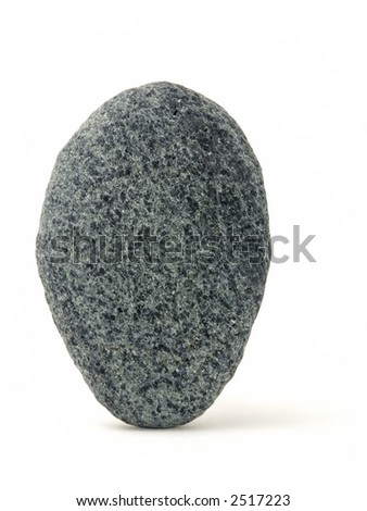 One rock carefully balanced on its end, isolated on white background. - stock photo