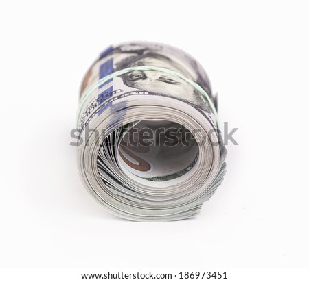 One roll from dollars on white background - stock photo
