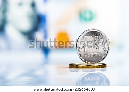 one Russian ruble coin against 100 us dollar banknote - stock photo