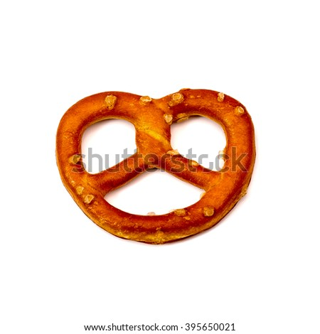 One salty pretzel on white background  - stock photo