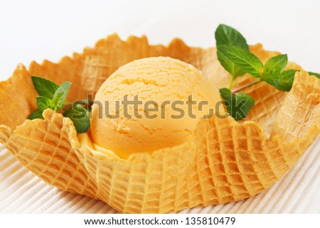 one scoop of fruity ice cream in a wafer cup - stock photo