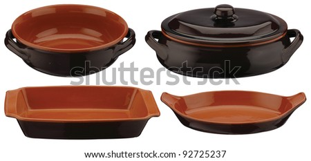 one set of terracotta cookware and trays - stock photo