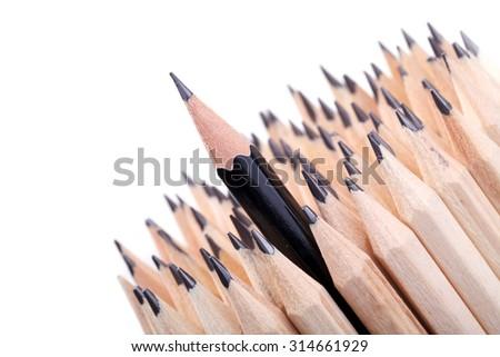 One sharpened black pencil among many ones - stock photo