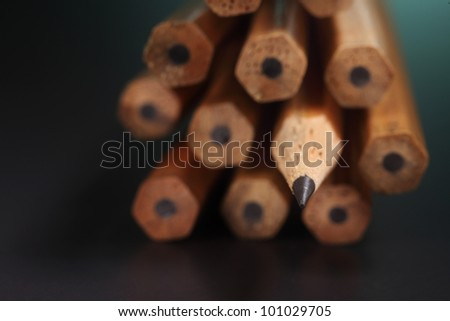 One sharpened pencils in row with pencil ends, - stock photo