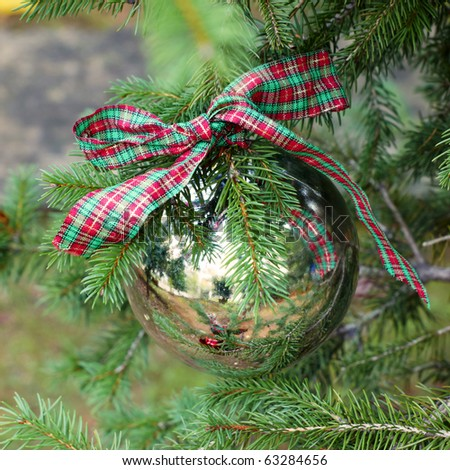 one silver Christmas  ball on fir branch - stock photo