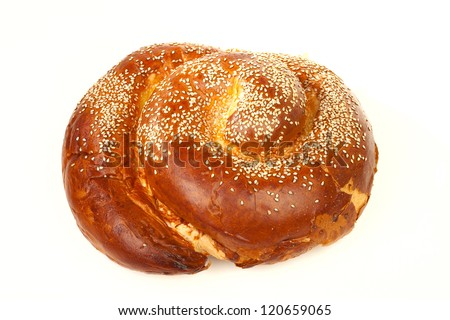 One simple sweet round sabbath challah with seeds isolated on white background - stock photo