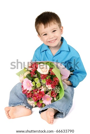 One sitting boy with bouquet of miscellaneous flowers isolated on white background - stock photo