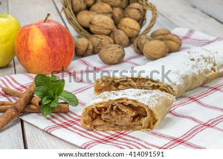 One Slice Homemade Apple Strudel with Cinnamon, Mint and Apple - stock photo