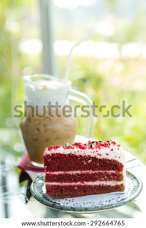 one slice of red velvet cake in front of the whole dessert, red velvet cake - stock photo