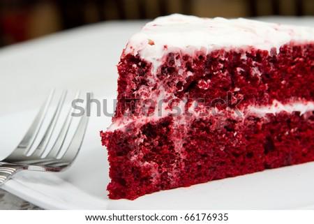 one slice of red velvet cake on a white plate - stock photo