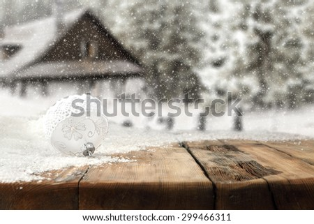 one small ball of white color and home in snow  - stock photo