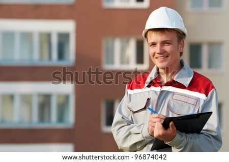 One smiling surveyor worker with clipboard outdoors input the data - stock photo