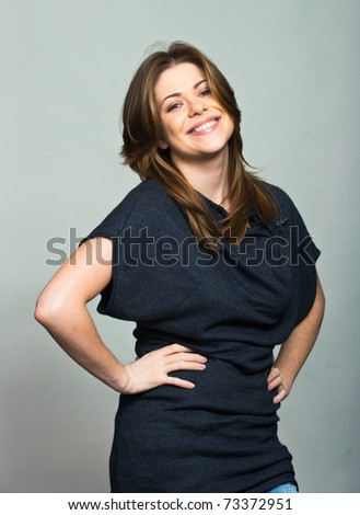 One smiling woman on gray background - stock photo
