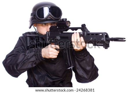 one soldier with the gun in the hands on a white background - stock photo