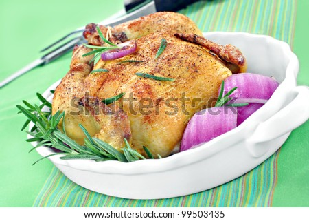 One spiced and roasted game hen or chicken up close, slanted. - stock photo