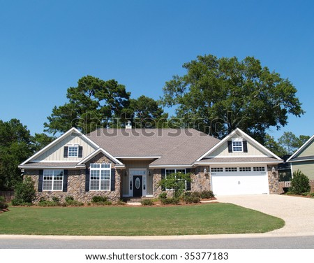 One story residential home with a stone  facade. - stock photo
