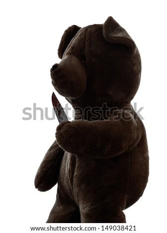 one  strange killer teddy bear holding bloody knife  in silhouette white background - stock photo