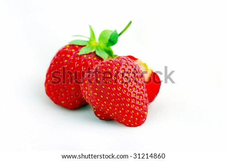 One strawbbery and two piece of strawberry. - stock photo