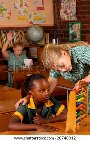 One student helping another with selective focus - stock photo