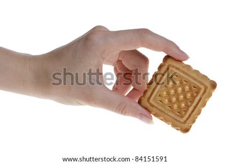 one tasty cookie in woman's hand. Isolated on white background