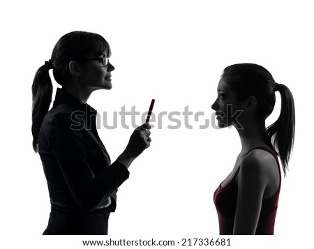 one  teacher woman mother teenager girl discussion in silhouette studio isolated on white background - stock photo