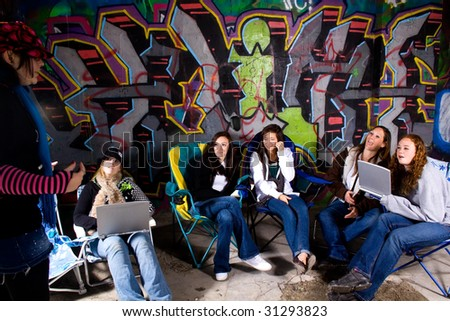 One Teenager talking to the others - stock photo