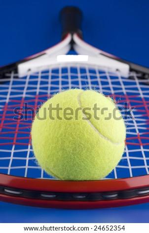 One tennis ball on a tennis racket. - stock photo