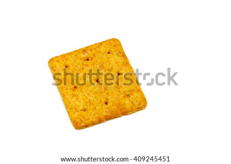 One thin square organic wheat baked cracker or biscuit over white. Not Isolated. - stock photo