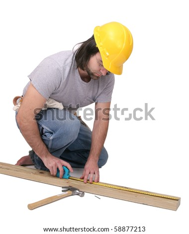 one thirties adult man doing carpentry work over white - stock photo