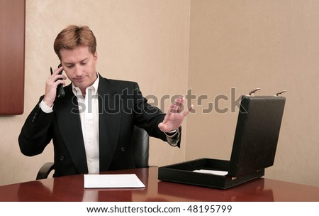 one thirties businessman talking on the phone in a business room or office