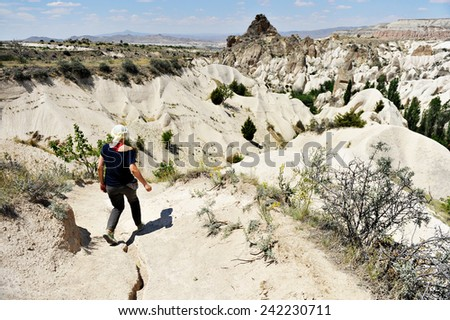 One tourist trekking in the Rose Valley of Cappadocia - stock photo