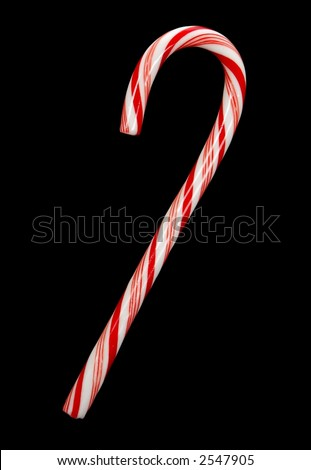 One traditional candy cane isolated on black background.