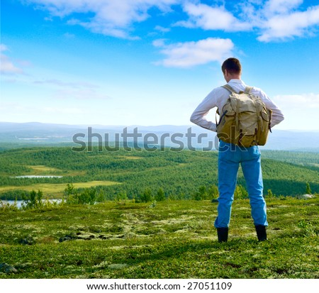 one traveler walking in north mountain tundra