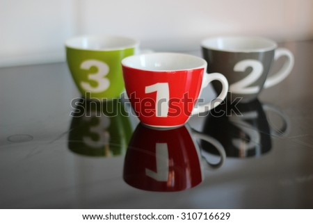 One two three coffee cup - winner - first place - stock photo