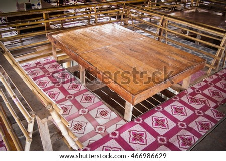 One typical Thai style wooden table that you can put yours leg under the table while you are eating comfortably.