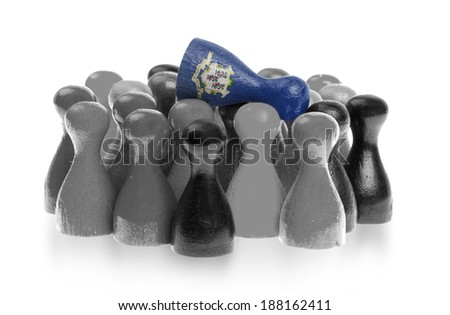 One unique pawn on top of common pawns, flag of Connecticut - stock photo