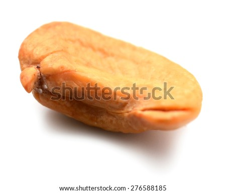 One unshelled roasted cashew nut, isolated on white. This shot is made with stacking technology from 12 separate shots with different focus point and has extremely high depth of field and sharpness. - stock photo