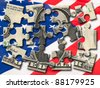 One US Dollar Banknote Puzzle on American Flag - stock photo