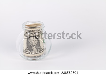 One US dollars bank notes in a glass jar isolated on white background - stock photo