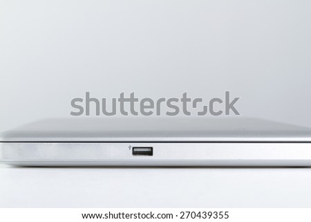 One USB plug in a laptop over a white background - stock photo