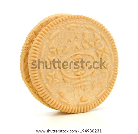 One vanilla sandwich cookie on white - stock photo