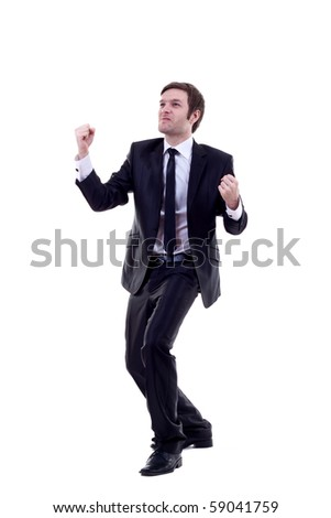 One very happy energetic business man with his arms raised. - stock photo